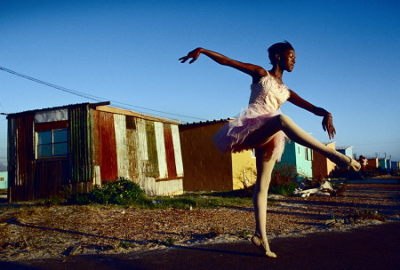 South Africa, Noluyanda Mqutwana strikes a pose outside her small family house in Khayelitsha, the biggest black township, outside Cape Town, South Africa. Noluyanda is one of about 200 unprivileged children dancing ballet in a program called Dance For All, Many children are talented and the discipline taught during the dance classes has helped many to improve their concentration in school. Some children has blossomed to careers in dance in South Africa and internationally.