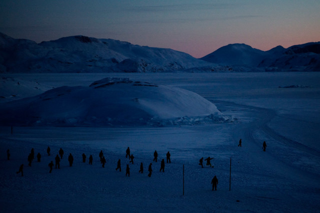 Inhabitants from the small village Aappilattoq in Greenland meet for a football game on the ice in the afternoon. Foto: Andrea Gjestvang